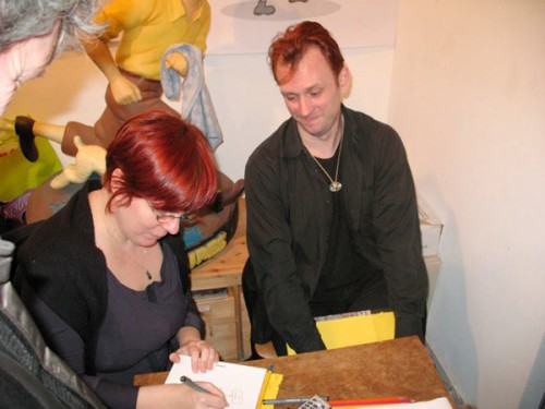 Yiri and me, signing away